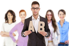 Successful businessman leading a group with letters Stock Image