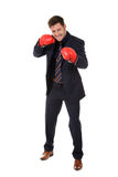 Successful businessman, left hand punch Stock Photo