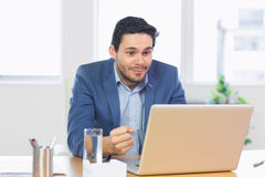 Successful businessman looking at laptop Royalty Free Stock Image