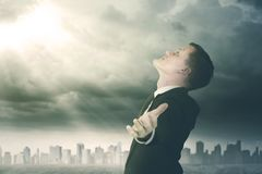 Successful businessman looking at a sunlight Royalty Free Stock Photography