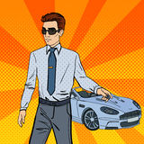 Successful Businessman. Man Holding a Car Key. Pop Art Stock Image