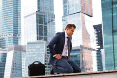 Successful businessman meditation. On the background of office buildings Stock Photo