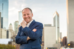 Successful businessman among office buildings. Royalty Free Stock Photo