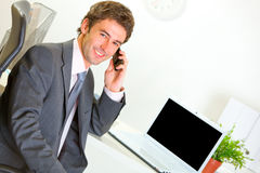 Successful businessman in office making phone call Stock Photo