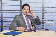 Successful businessman in the office Royalty Free Stock Images