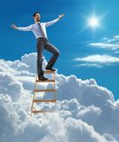 Successful businessman with open arms standing at  Stock Images