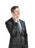 Successful businessman with phone Stock Images