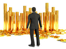 Successful businessman and pile of dollar gold coins Stock Photo