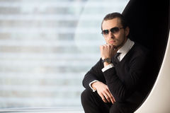 Successful businessman posing in luxury apartments Royalty Free Stock Photo