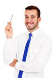 Successful businessman posing with a pen Stock Image