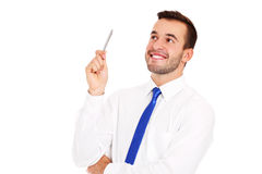 Successful businessman posing with a pen Stock Images