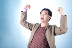 Successful businessman punching the air with his fists in air, s Royalty Free Stock Image