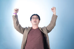 Successful businessman punching the air with his fists in air, s Royalty Free Stock Images