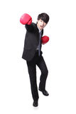 Successful businessman punching and hitting Royalty Free Stock Photo