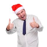 Successful businessman with red santa cap Royalty Free Stock Photography