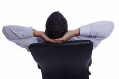 Successful businessman relaxing, from back Stock Photography