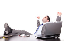 Successful businessman relaxing over desk Royalty Free Stock Photography
