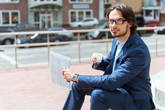 Successful businessman resting with hot drink Stock Photos