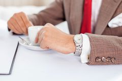 Successful businessman is resting in restaurant Royalty Free Stock Photos