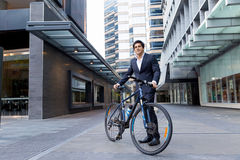 Successful businessman riding bicycle Royalty Free Stock Photo