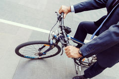 Successful businessman riding bicycle Royalty Free Stock Photography