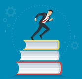 Successful businessman running on books icon design vector illustration, education concepts Stock Photos