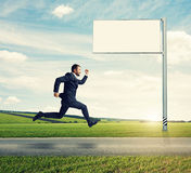 Successful businessman running Stock Photography