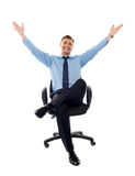 Successful businessman seated on chair Stock Photos
