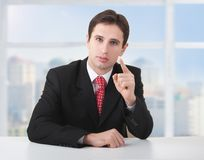 Successful businessman seriously sitting at desk Royalty Free Stock Photo