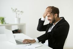Free Successful Businessman Shocked By Unbelievable Online Win Lookin Stock Photography - 109507112
