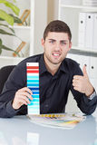 Successful businessman showing color palettes. Young successful businessman showing color palettes stock photography
