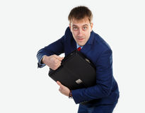 Successful businessman showing themselves. In his hand is holdingportfolio Royalty Free Stock Photo