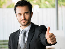 Successful businessman showing thumb up,office worker,business decisions Stock Images