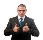 Successful businessman showing thumbs up. Handsome successful businessman showing thumbs up isolated on white Royalty Free Stock Images