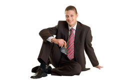 Successful Businessman sits with cigar on floor Royalty Free Stock Photos