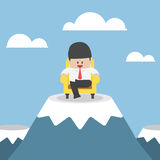 Successful businessman is sitting on sofa at mountain peak. VECTOR, EPS10 Stock Photo