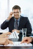 Successful businessman smiling Stock Photos