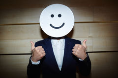 Successful Businessman in Smiling Mask Royalty Free Stock Photos