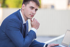 Successful businessman standing in the street Stock Photos