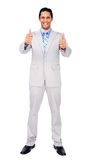 Successful businessman standing with thumbs up Royalty Free Stock Image