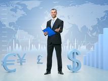 Successful businessman on stock exchange background. Concept of success stock photo
