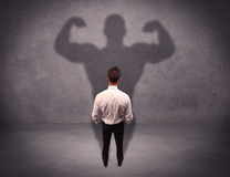 Successful businessman with strong shadow Royalty Free Stock Images
