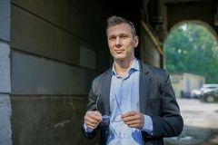 Successful businessman in suit surely standing in the city royalty free stock image
