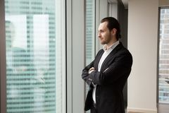 Successful young handsome businessman standing in the modern off stock photo