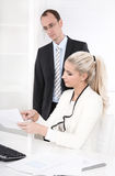 Successful businessman with suit and tie talking with his blond Royalty Free Stock Photo