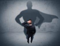 Successful businessman with superhero shadow Stock Photo