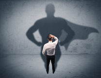 Successful businessman with superhero shadow Royalty Free Stock Images