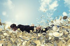 Businessman swims in a sea of money. Successful businessman swims in a sea of money stock images