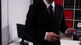Successful businessman with tablet PC in office stock footage