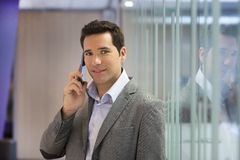Successful businessman talking on cell phone Stock Image